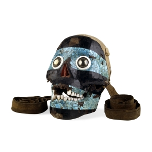 A mask made from a human skull with the back removed and lined with dear skin to be worn as a mask. This is meant to represent Tezcatlipoca, or 'Smoking Mirror', one of the four Aztec creator deities.