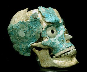 A skull partially covered in jade, from Monte Alban Tomb 7. Interestingly, this skull was heald for a time at a convent.