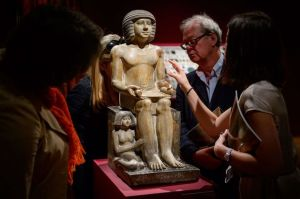 Christie's staff view the statue. Image: mirror.co.uk