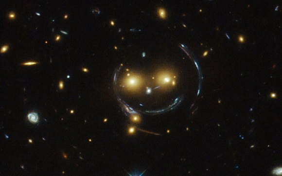 "A cosmic ""face"" in the galaxy cluster SDSS J1038+4849. Image: NASA"